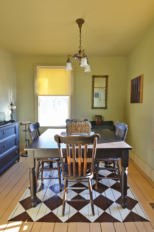 dining room with painted wooden checkered floor