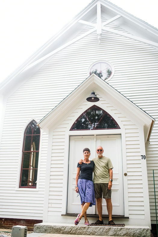 Francelle Carapetyan and husband Peter Bixby infront of house