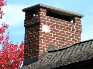 Chimney with rain cap and flashing