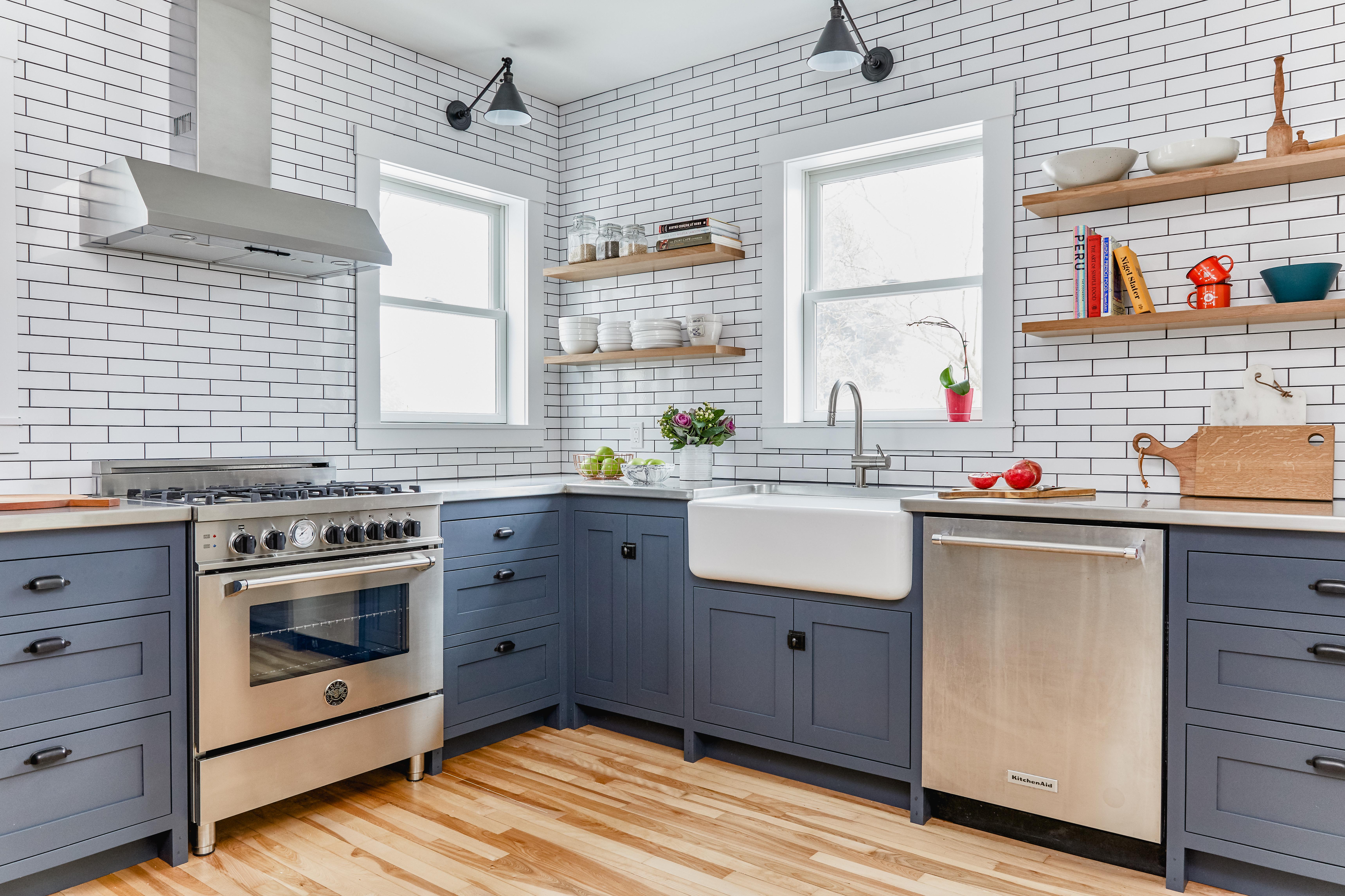 grey kitchen with white subway tile