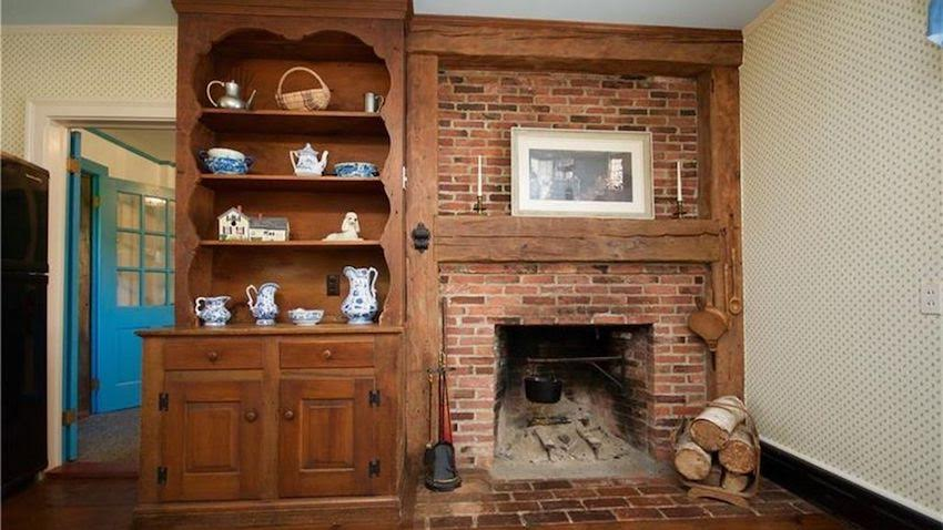 old fireplace and cabinet