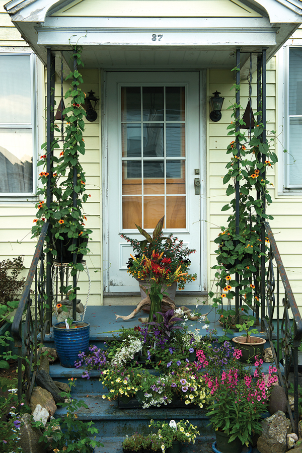 Herlihy's front entry is filled with potted plants, some destined for her clients' garden beds.