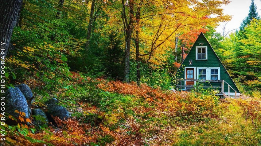 Maine A-frame cabin with fall foliage