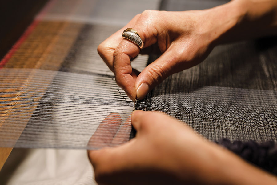 Emi Ito weaving at her a Swedish countermarch loom
