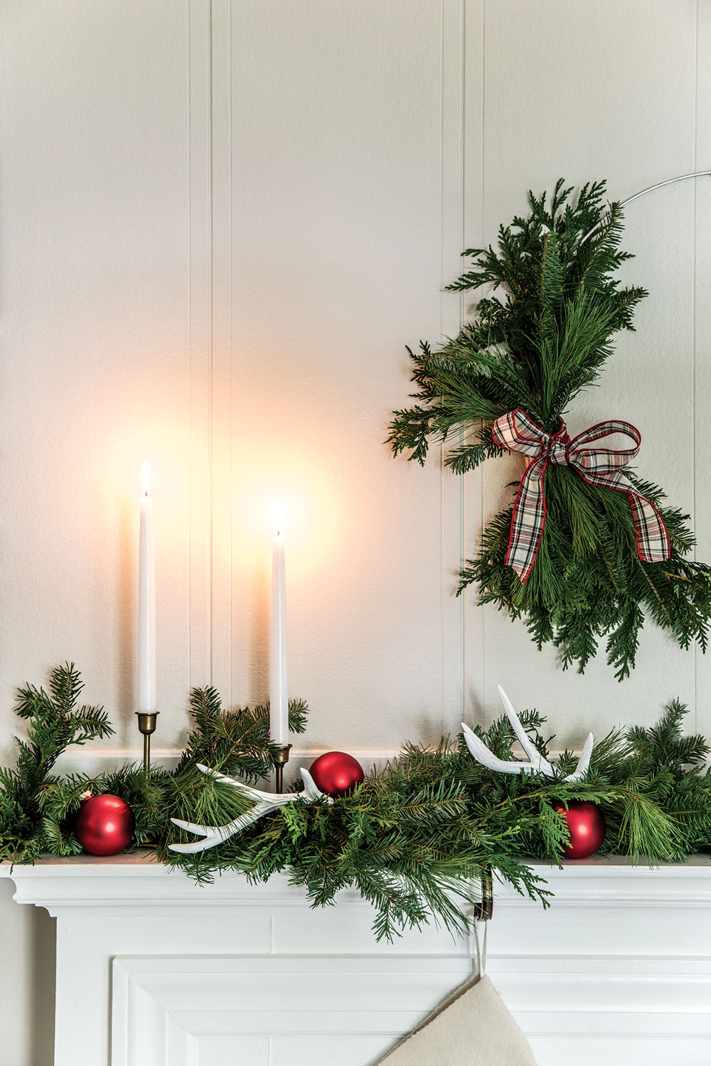 holiday décor ideas, mantel greens, antique candlesticks, and deer antlers
