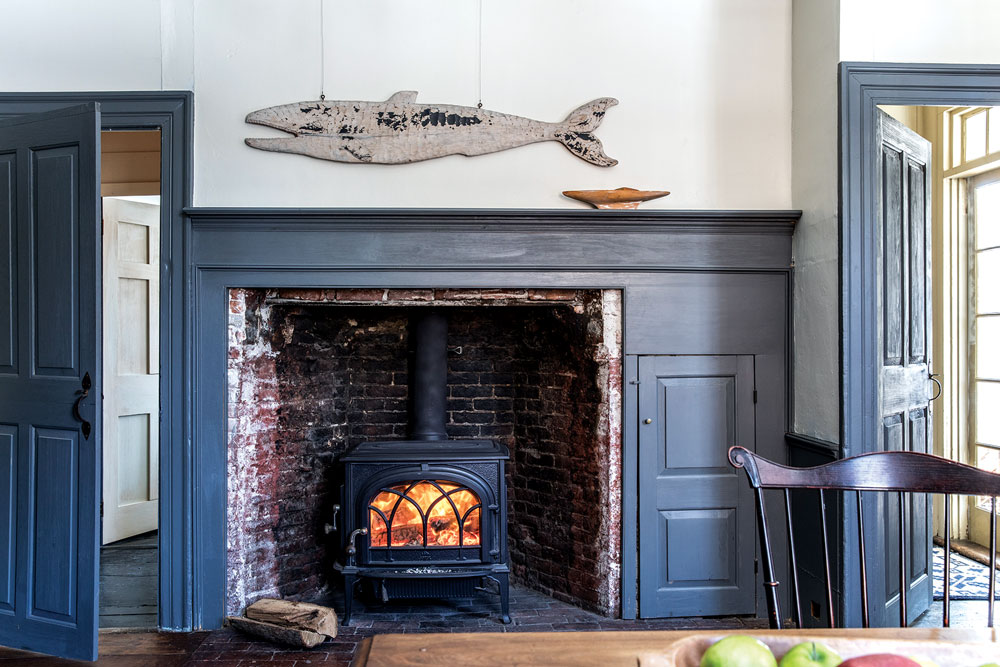Americana wooden whale over the restored fireplace