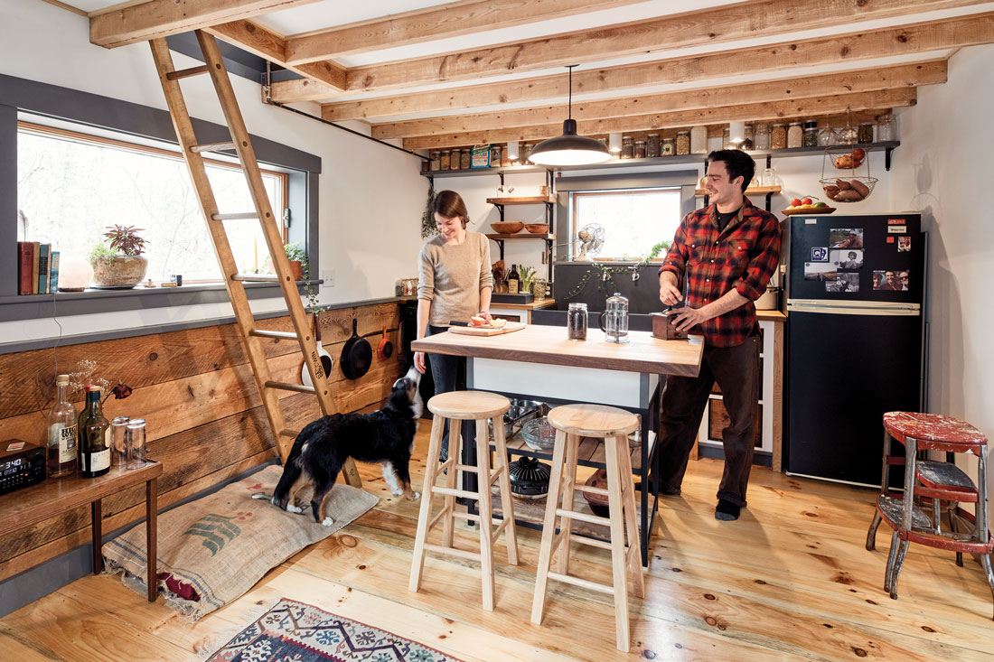 Nadejda Stancioff, Abe Goodale, and their Australian shepherd, Laika, gather in their tiny Camden home's roomy kitchen