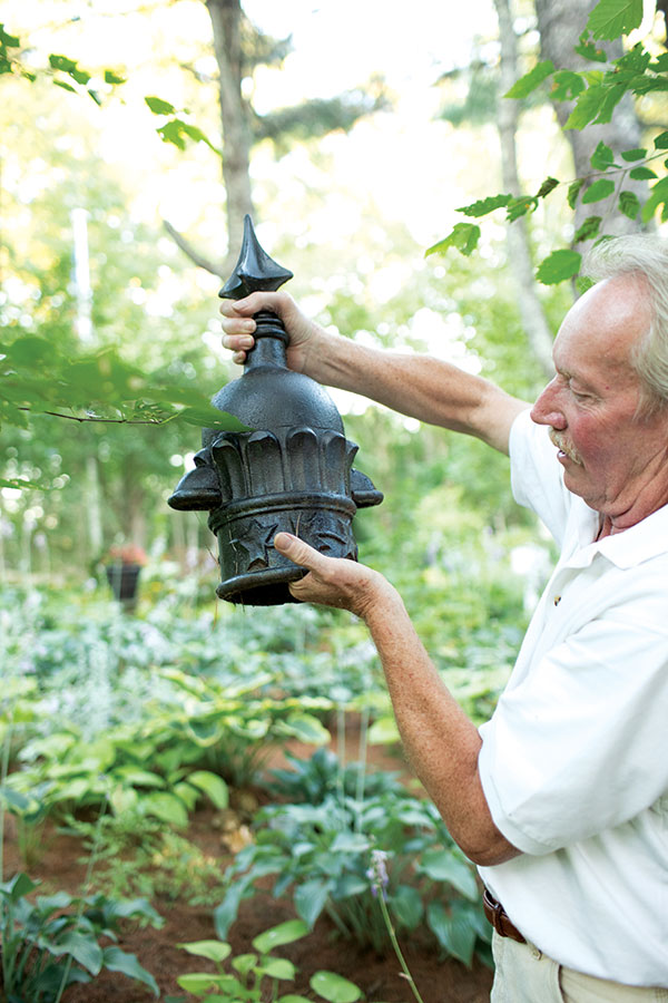 Eric Allen holding architectural salvage turned garden ornament