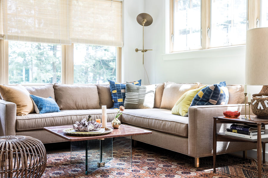 After: A custom sectional from Portland's Home Remedies hugs a corner of the revamped living room