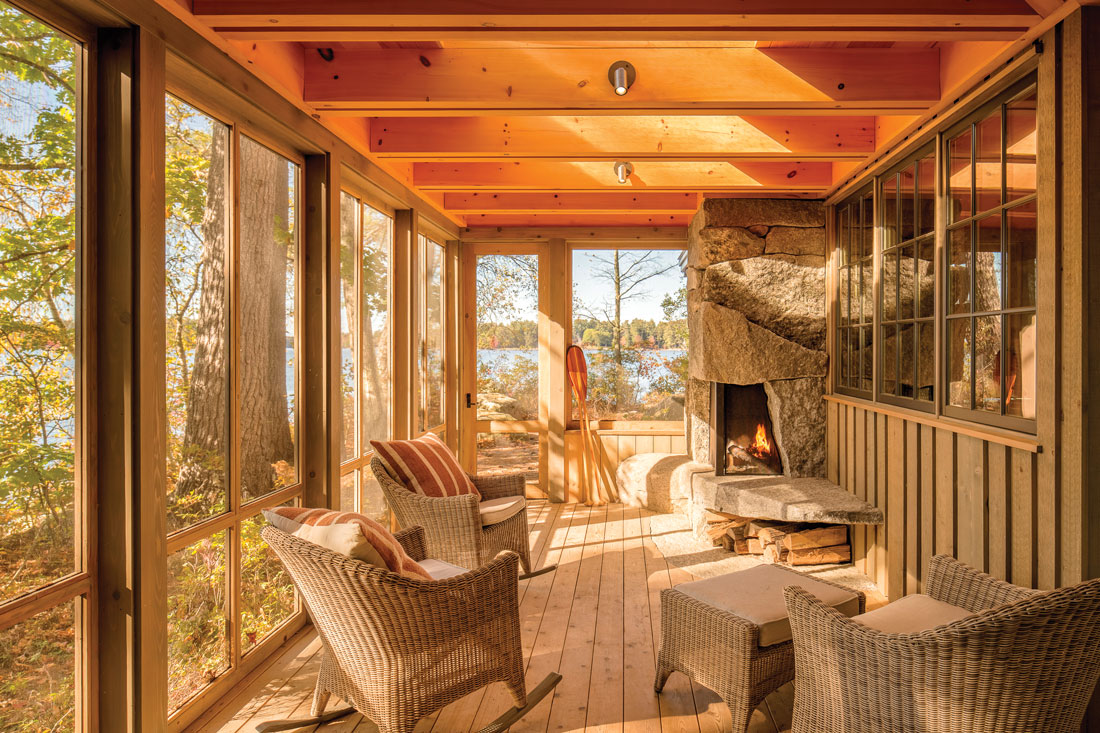 outdoor fireplace on screened porch that faces Sebago Lake