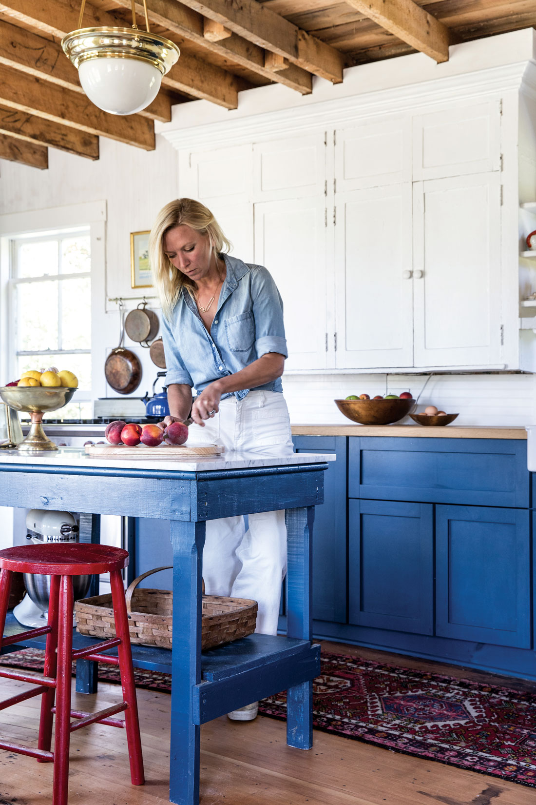 The Stonington kitchen Christina Salway and John Moskowitz rehabbed centers on an antique workbench topped with Carrara marble from Sedgwick's The Granite Shop. It's painted Benjamin Moore's Gentleman's Gray like the Ikea lower cabinets; Chantilly Lace, also by Benjamin Moore, brightens the original uppers