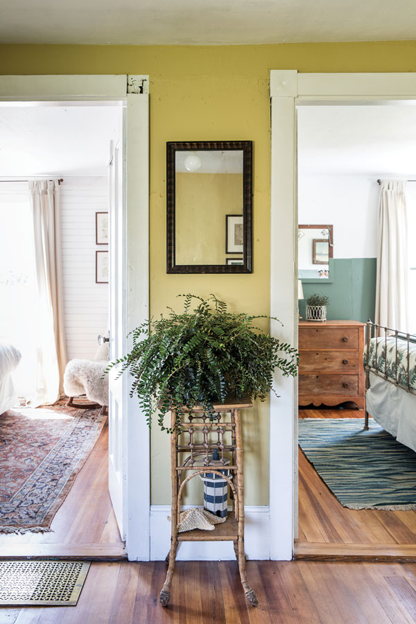 The upstairs hallway's mustard-yellow hue — Wythe Gold by Benjamin Moore — came to Salway in a dream.