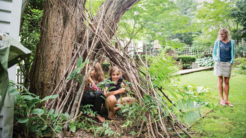 Susan A. Olcott and her kids in their backyard in Brunswick, Maine