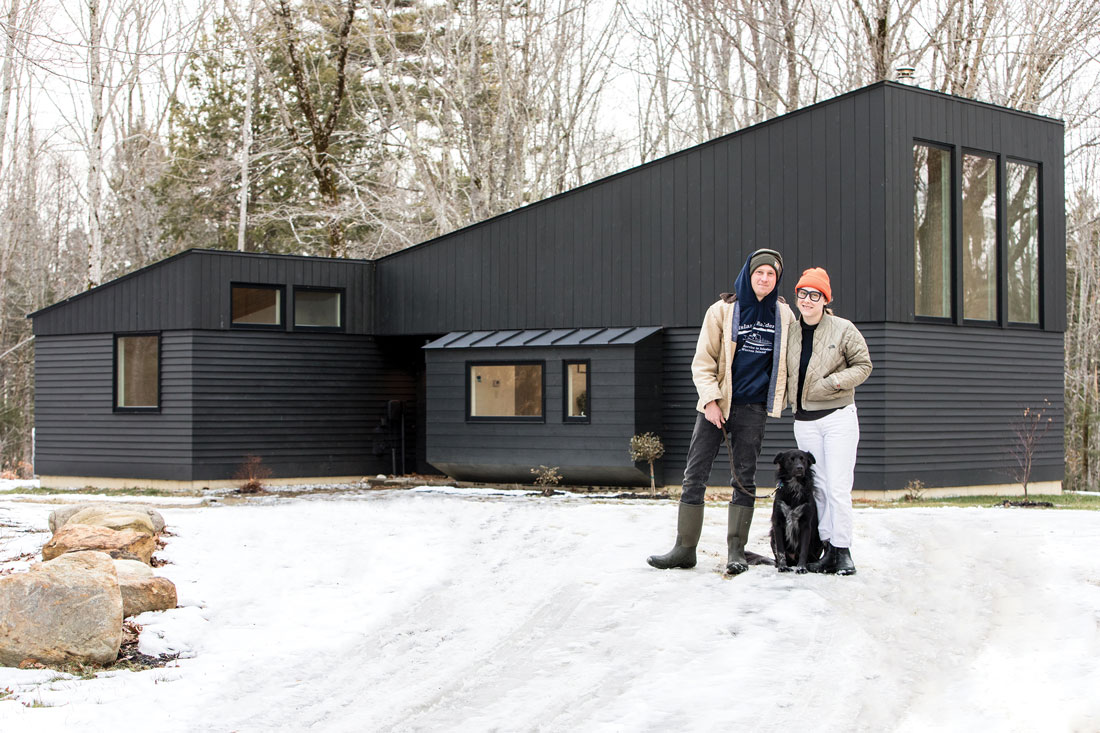 Ariel Birke and Luke Olson outside of their Lincolnville home