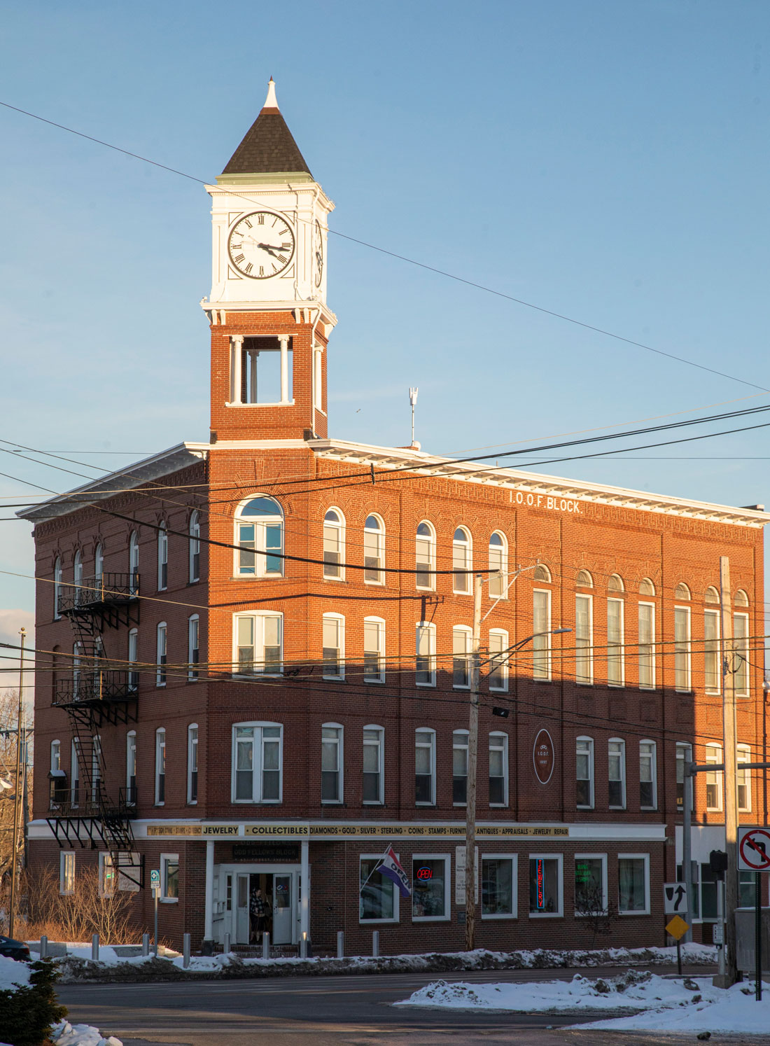 The clock atop the tower on Forest Avenue's Odd Fellows Block
