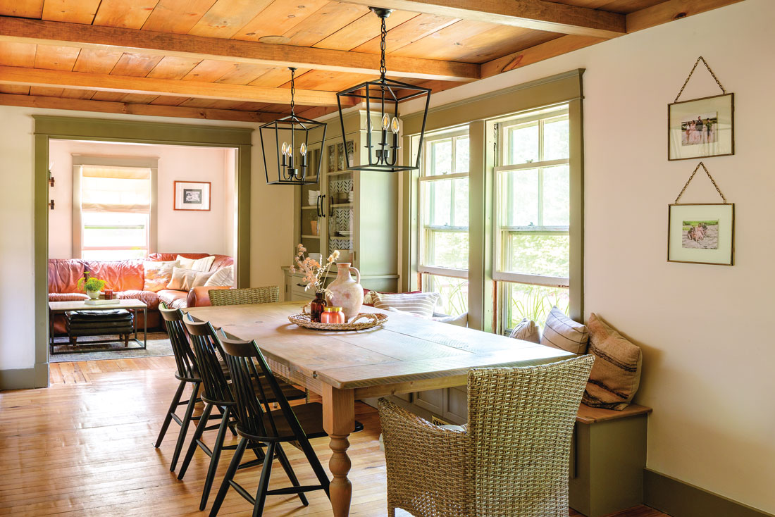 Wayfair lanterns, spindled chairs from Overstock, and all-weather wicker armchairs, nabbed during a Pier 1 going-out-of-business sale, set off the dining table.