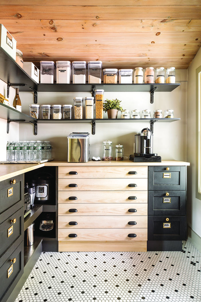 Tanya spent nearly a year building this pantry in a former office using drawer units and a laminate countertop from IKEA and bracket shelving from Lowe's.