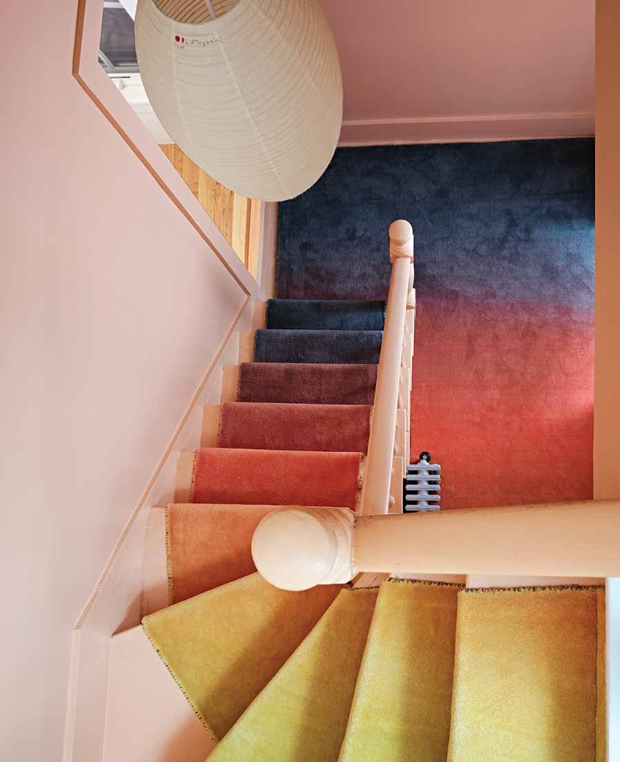 An ombré runner enlivens the stairwell.