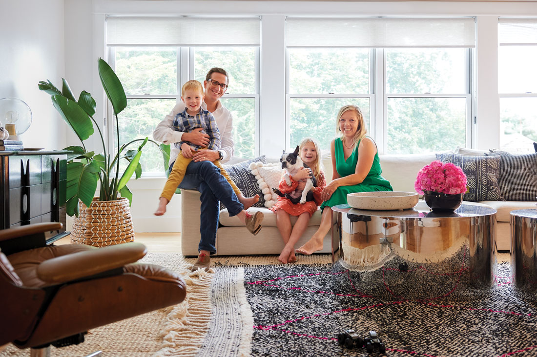 Gavin and Carly Blackmore, their son, Lawson, daughter, Maeve, and Boston terrier, Tux, in their Falmouth living room.