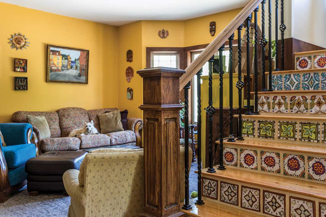 a central staircase decorated with tiles Sarah Sorenson modeled on Mexican pottery