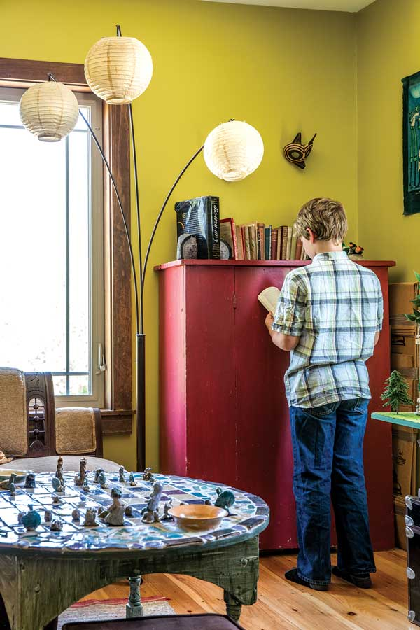 In the second-floor library, a card table rescued from the side of the road showcases a clay chess set