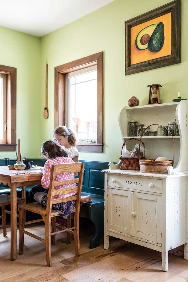 A spectrum of greens enlivens a kitchen corner with a hand-me-down table and chairs