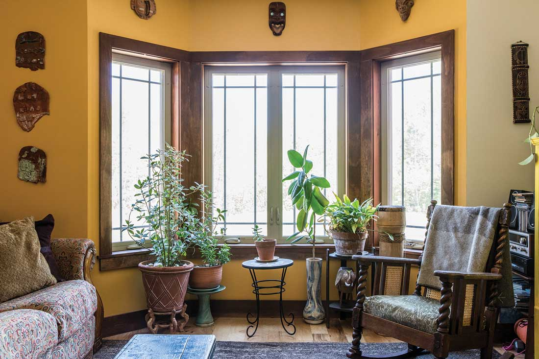 In the living room, the casements' modern grids nod to Spanish Revival iron grates, and their rich moldings reference the seating.