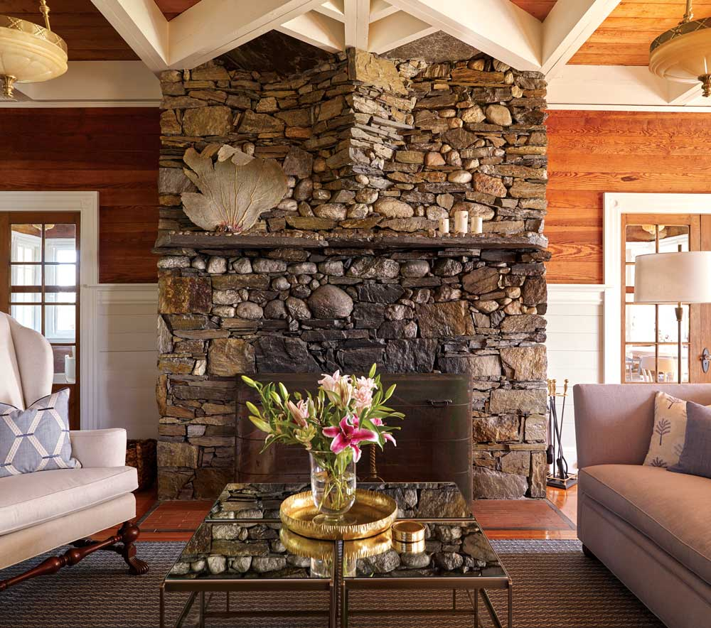 fieldstone living room fireplace is one of 13 in the 1898 Clapboard Island estate