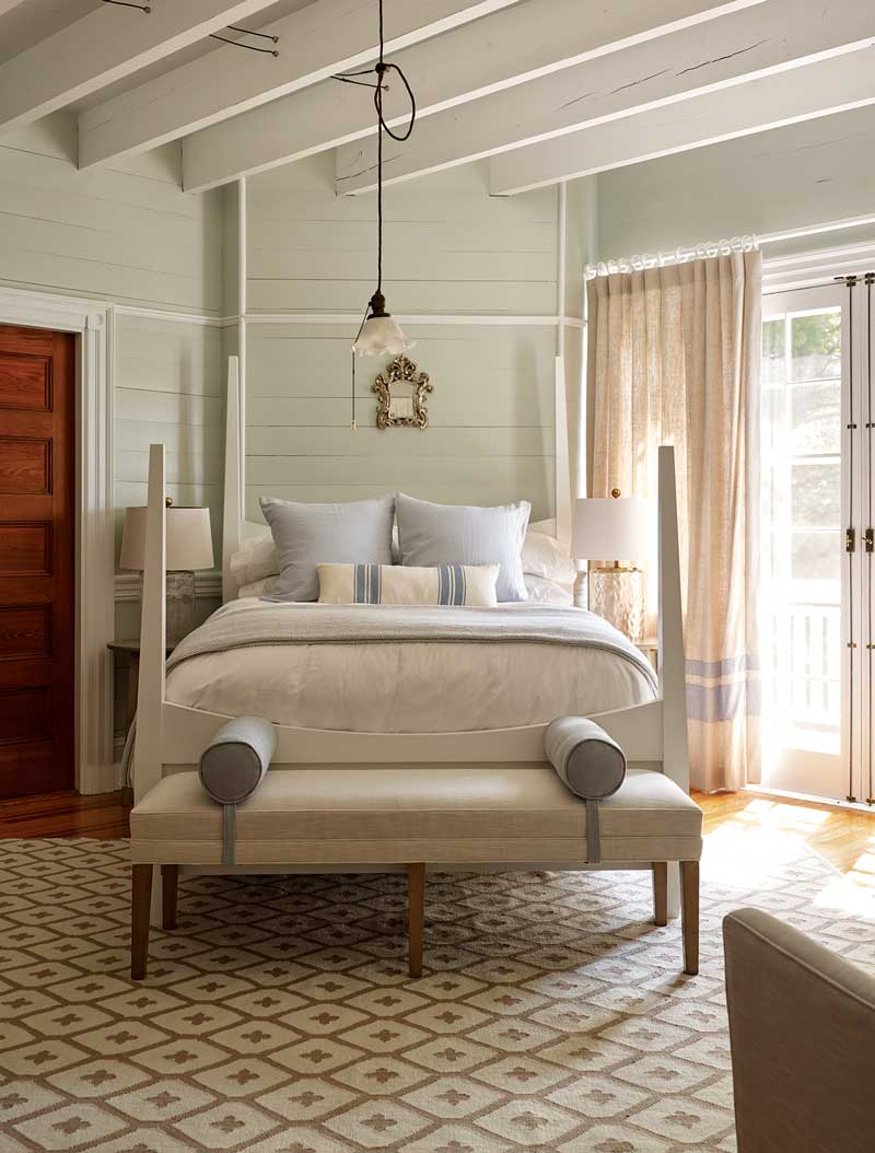 This serene second-floor bedroom is one of 13 in the estate.