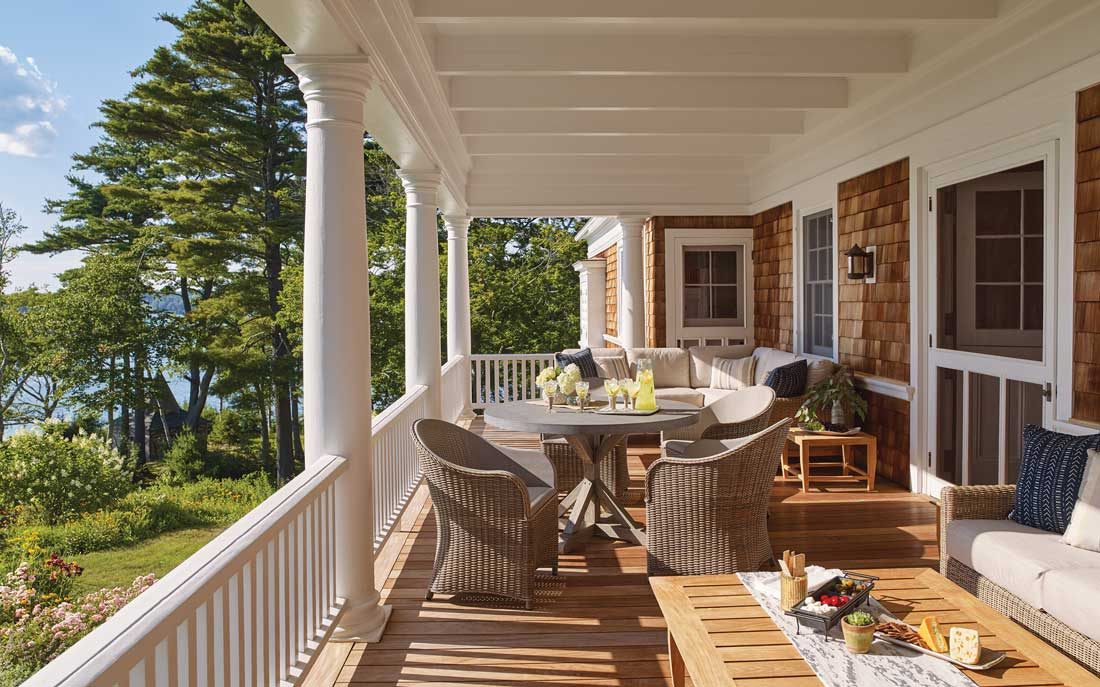 This west-facing porch received new ipe decking and all-weather-wicker furnishings; at left is a German-style garden house installed by the estate's original owner, Samuel Houston.