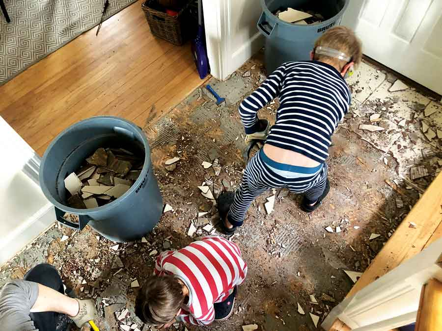 """Veteran home makeover show viewers, our kids exclaimed, """"We've got hardwood!"""" when we started pulling up the tile in our hall."""