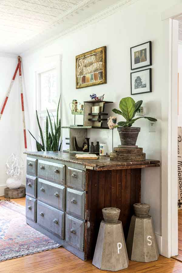 An antique hardware storage chest in the living room.