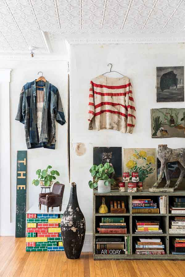 Old clothes with interesting patterns are art in the living room.