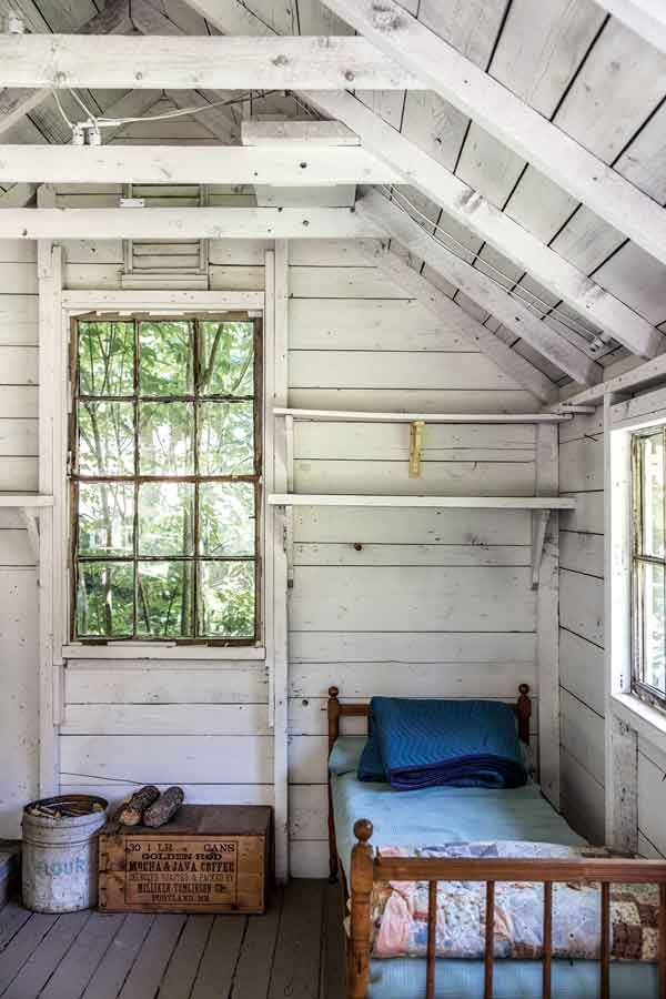 A rustically furnished former chicken coop in the backyard.