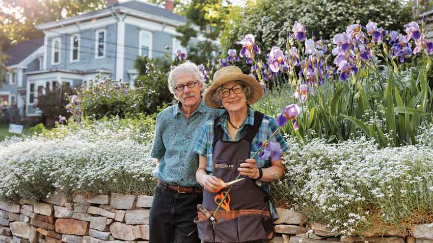 Nancy Montgomery and Jack L. Vreeland in front of their Portland garden