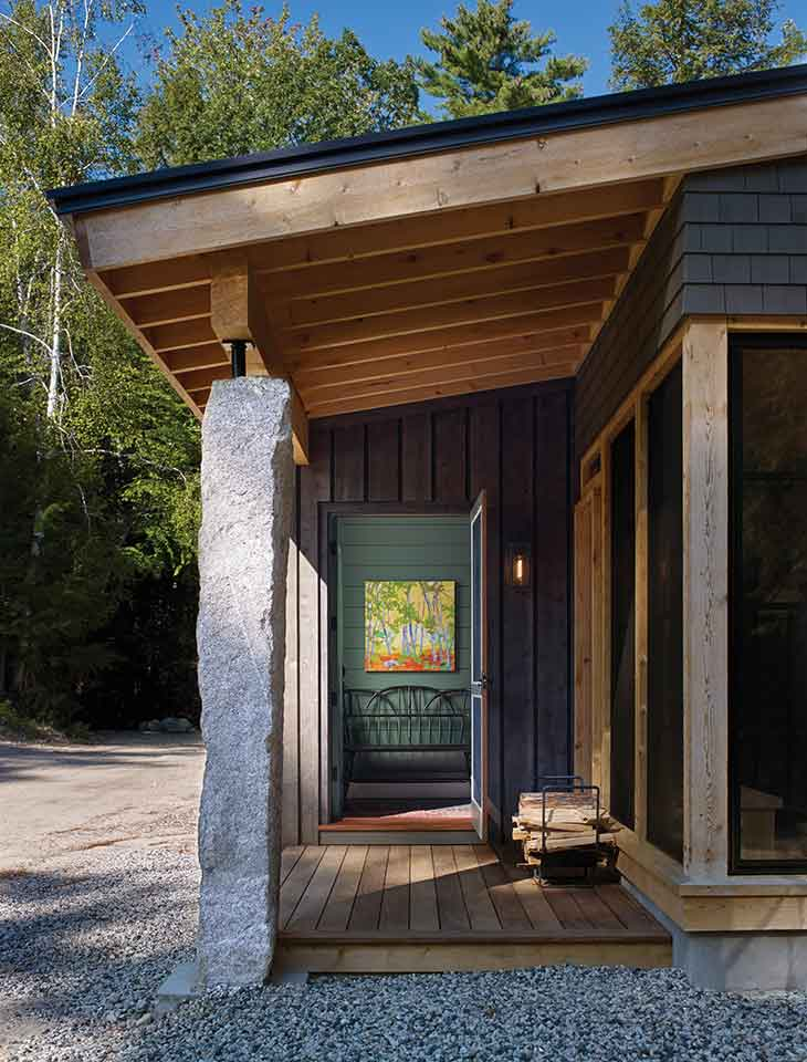 Granite remnants from the property serve as steps, a screened-porch hearth, and an entry-porch post.