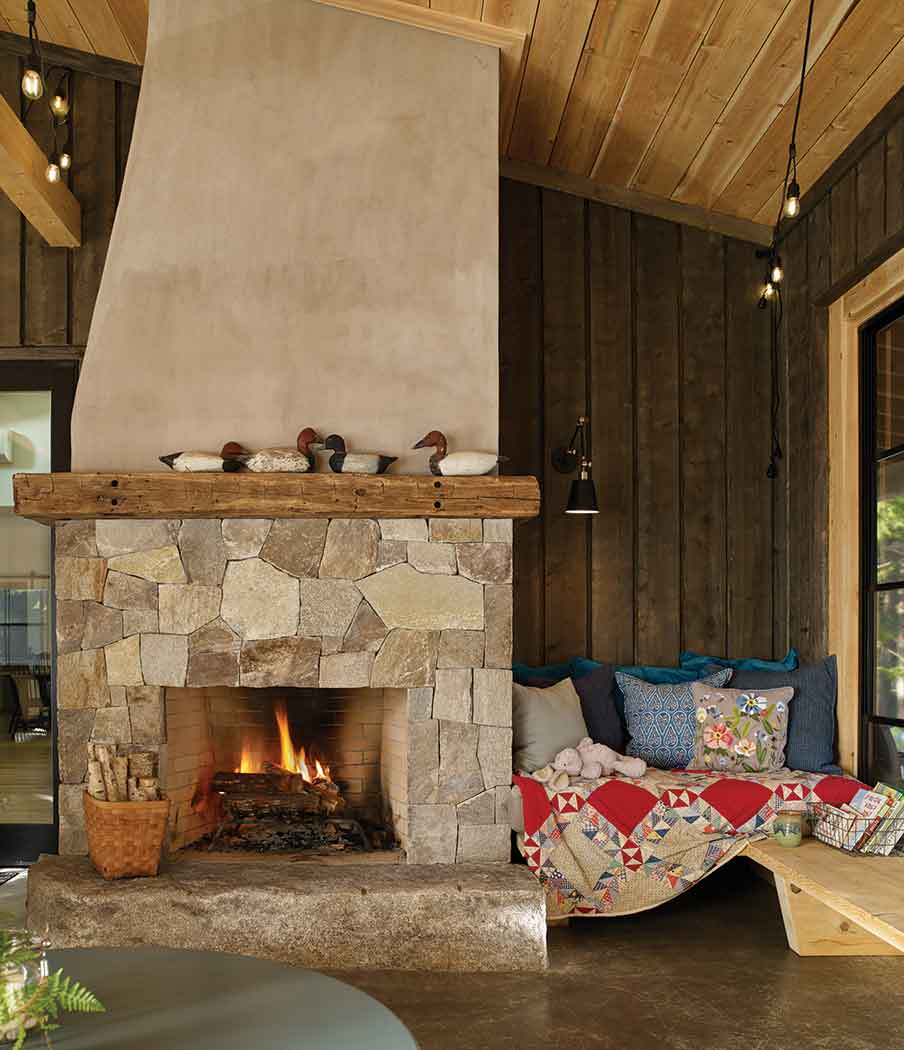 A granite fireplace assembled by Isaac N. Labbe Masonry, in Standish