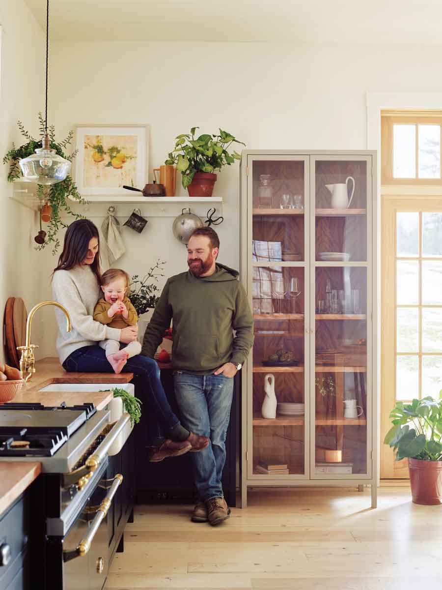 Morgan and Ben Block, owner of Block Brother's Custom Cabinets, and their 2-year-old son in their Morrill kitchen.