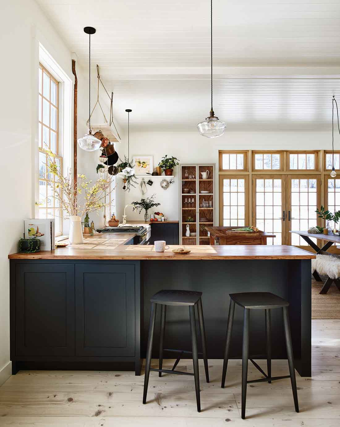 Morgan and Ben Block went with blue-black Shaker-style cabinets crowned with a pecan countertop in their kitchen