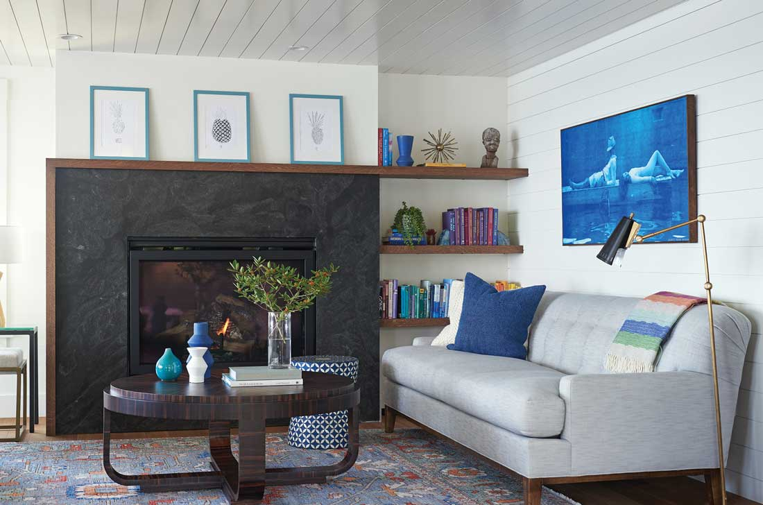 An arresting cyanotype by Portland's Ramble More Design sets the laid-back tone in a lower-level living room nook whose other focal point is an oak-wrapped fireplace that cleverly integrates floating shelves.