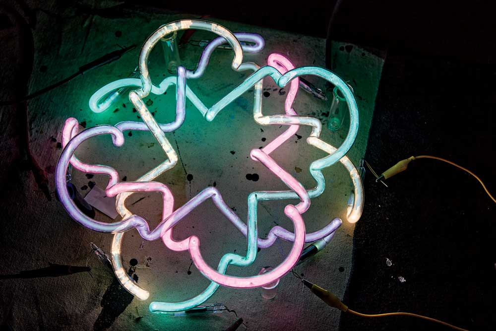 A flower-shaped neon light by Neon Dave, also known as David Johansen