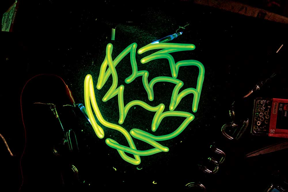 A hop-shaped neon light by Neon Dave, also known as David Johansen