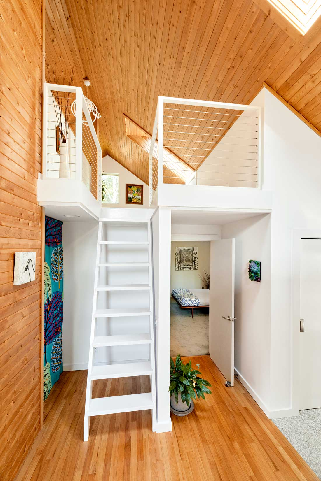 White paint and new cable railing transformed the entrance to the loft guest bedroom/office above the owners' suite.