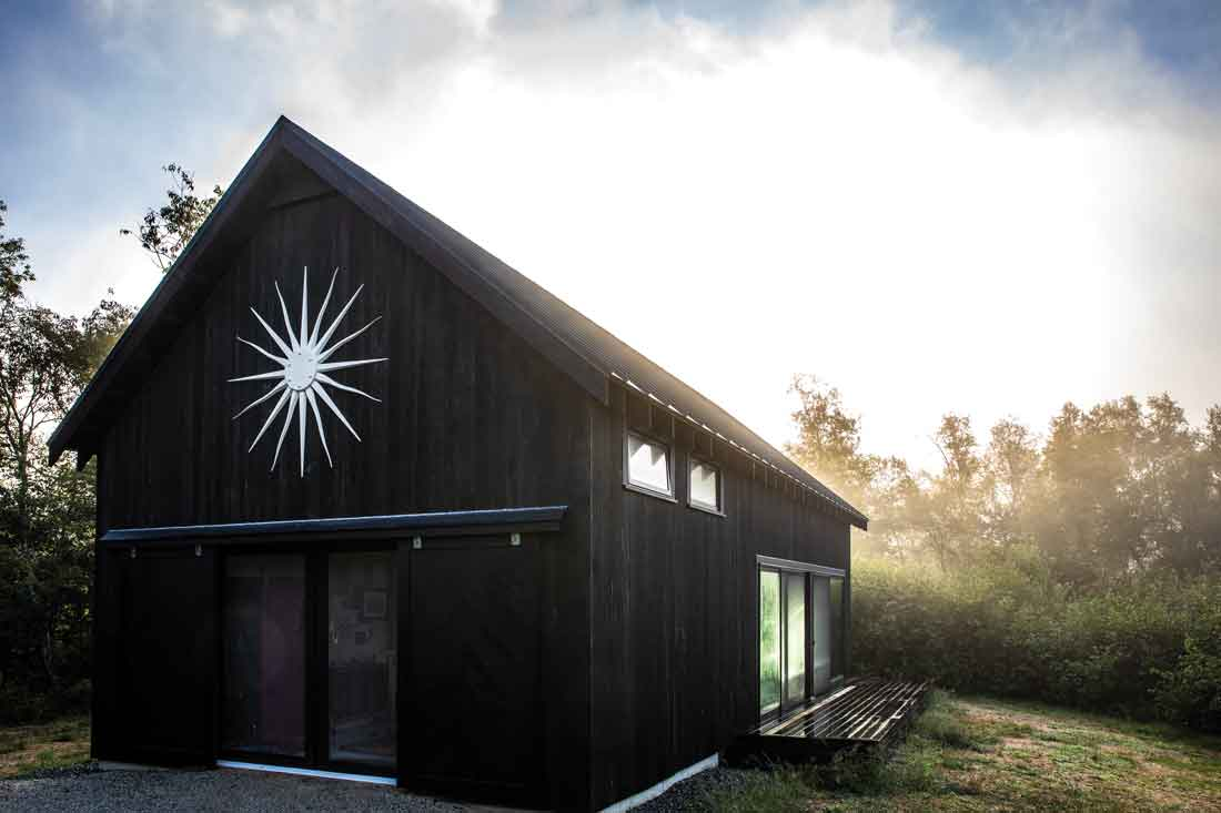 A sunburst, inspired by the work of design icon Tony Duquette, marks the pitch of the barn, the most recent addition to the property.