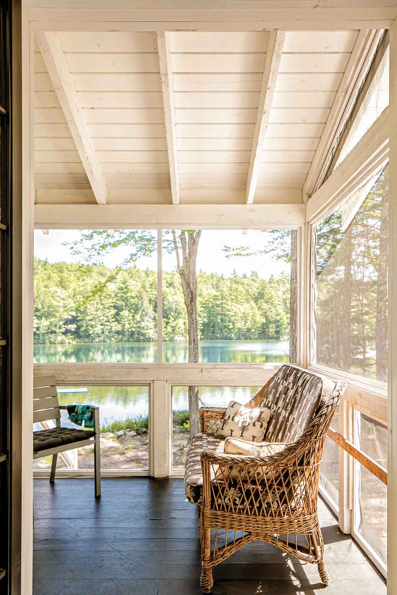 The couple's Windham screened porch features a wicker loveseat from Birlem's family's Boothbay cottage.