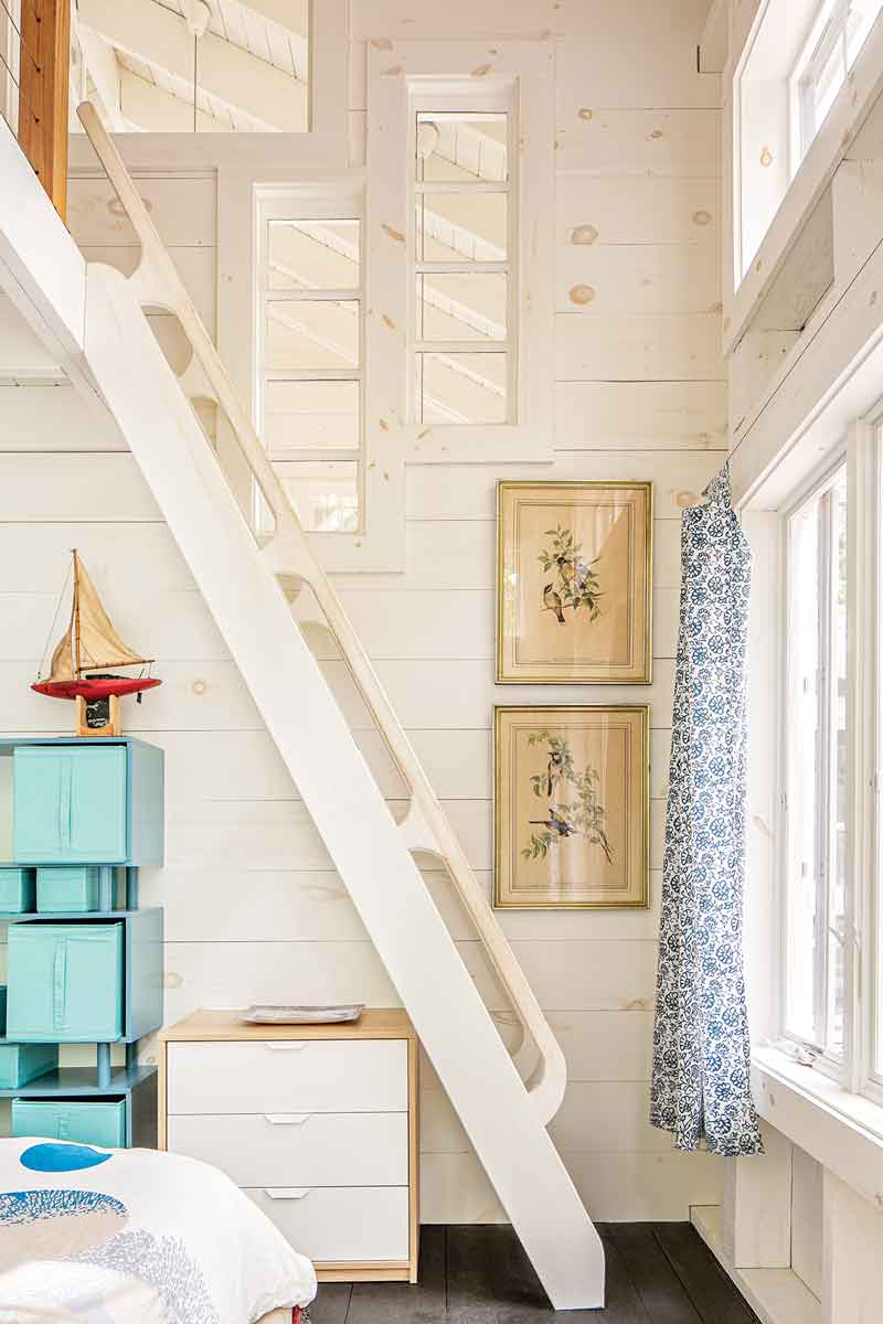 In the primary bedroom, Audubon prints from a former neighbor hang next to the ladder to the loft, built by Birlem's father.