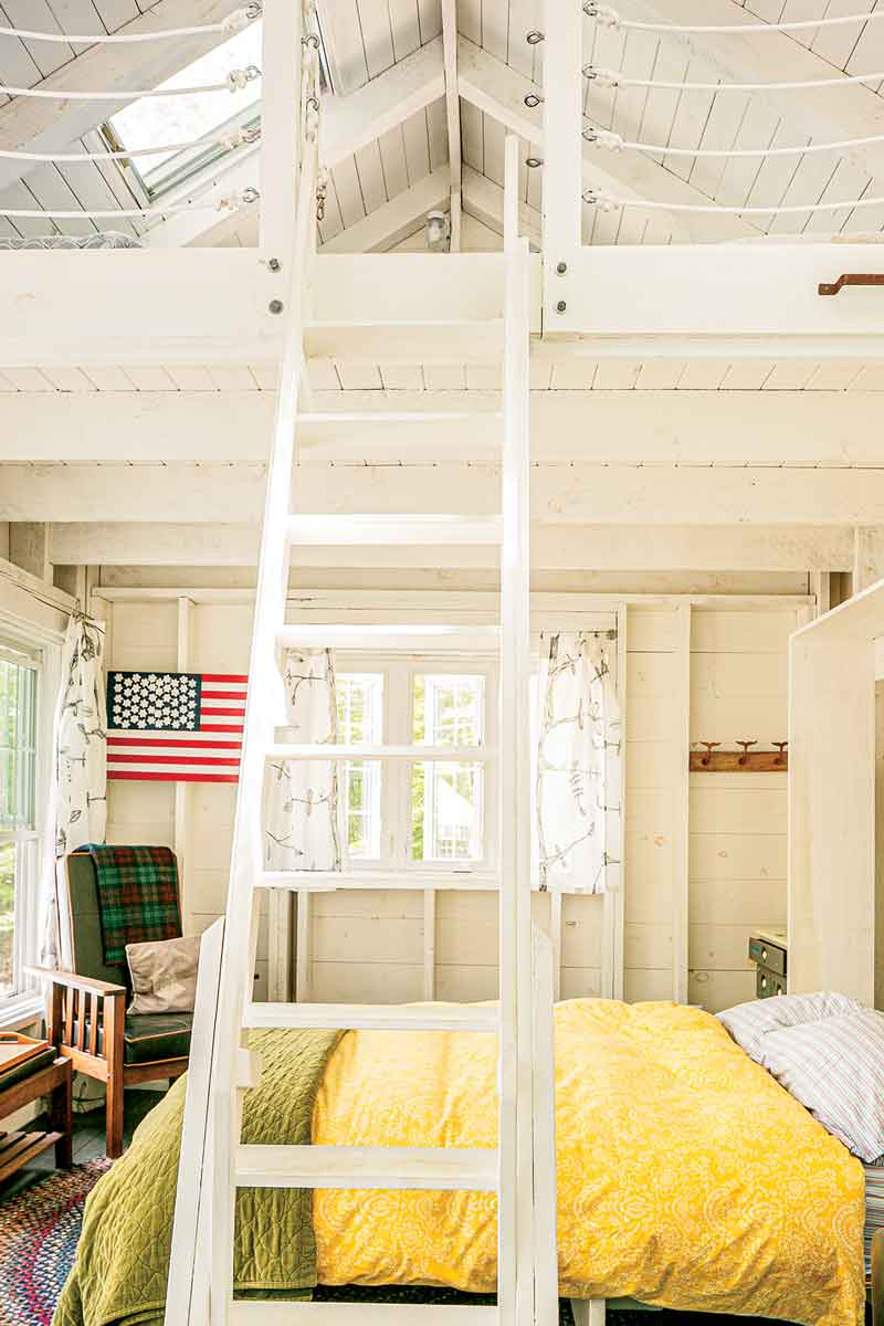 Birlem's dad also built the guesthouse ladder, and painted the flag in the corner; rope provides an economical railing in the loft.