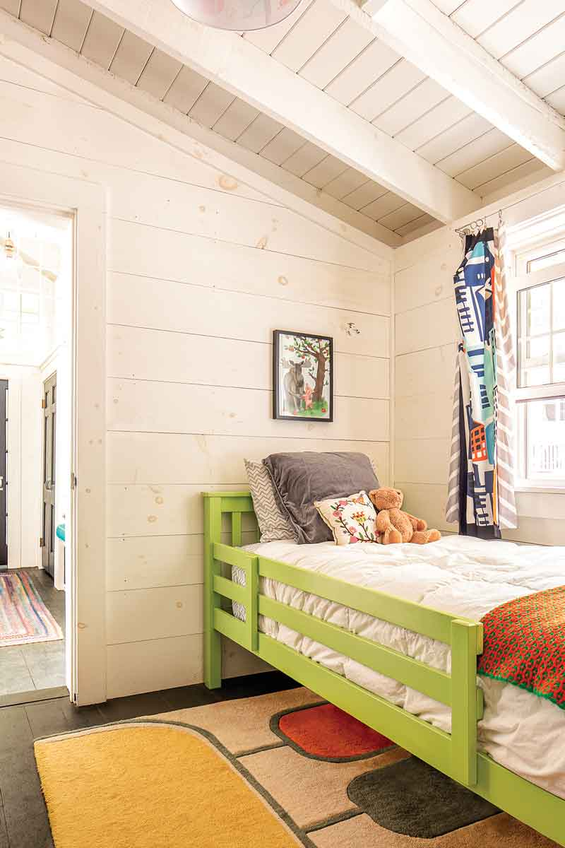Wallace's room, with a hand-me-down bed and IKEA-fabric curtains, is tucked into a former entryway.