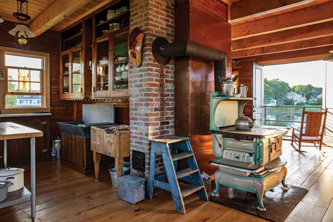 A cast-iron Atlantic stove — Zuke has salvaged dozens — warms the house on chilly days