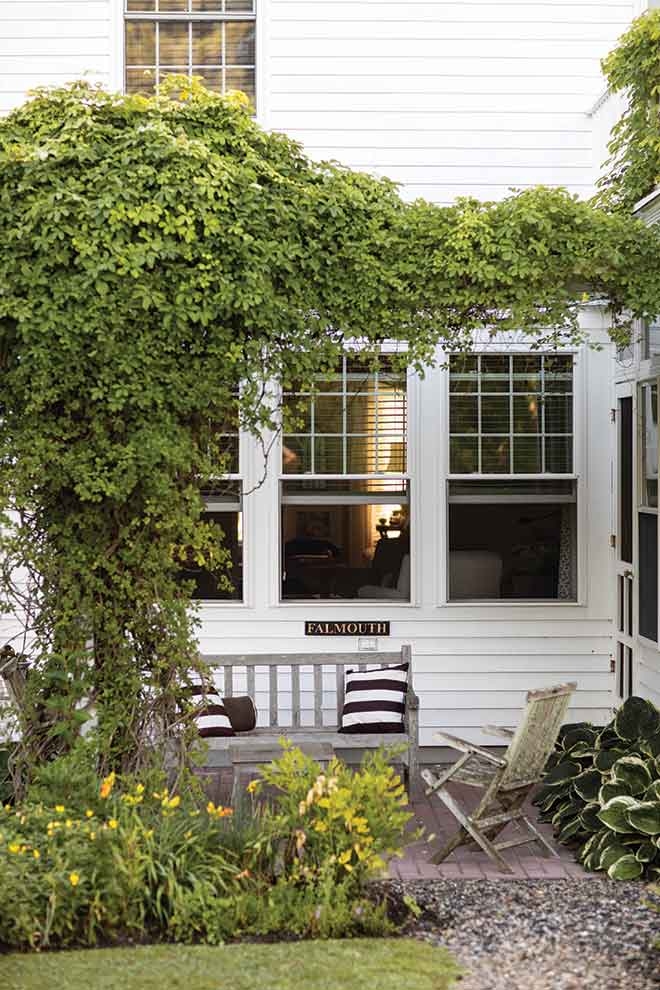a sitting-area arbor swathed in clematis and honeysuckle